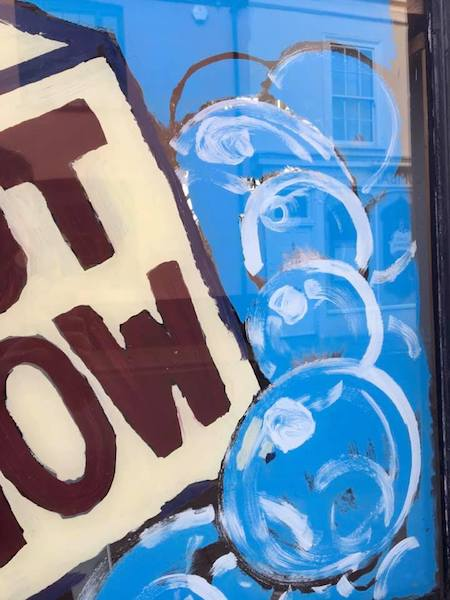 Dry Cleaning band 'New Long Leg' album laundrette window painting mural at Drift Record Shop in Totnes.